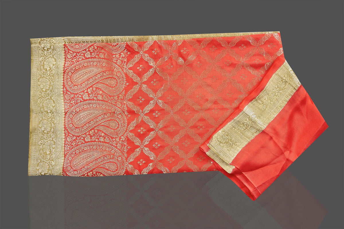 Shop stunning bright red color crepe saree online in USA with zari work. Shop for weddings and special occasions stunning tussar sarees, hand embroidered saris, crepe sarees, designer sarees in USA from Pure Elegance Indian clothing store in USA. Shop online now.-blouse