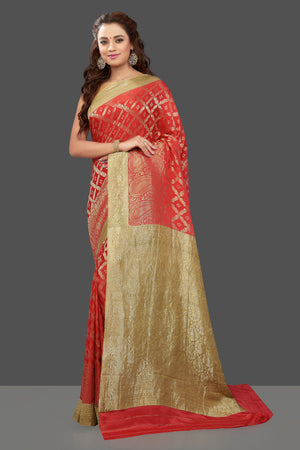 Shop stunning bright red color crepe saree online in USA with zari work. Shop for weddings and special occasions stunning tussar sarees, hand embroidered saris, crepe sarees, designer sarees in USA from Pure Elegance Indian clothing store in USA. Shop online now.-front