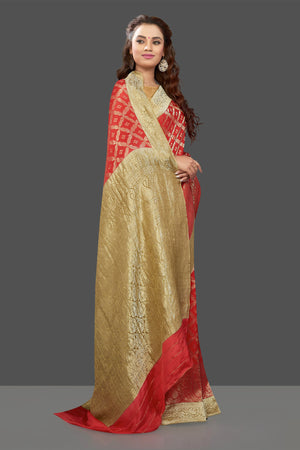 Shop stunning bright red color crepe saree online in USA with zari work. Shop for weddings and special occasions stunning tussar sarees, hand embroidered saris, crepe sarees, designer sarees in USA from Pure Elegance Indian clothing store in USA. Shop online now.-side