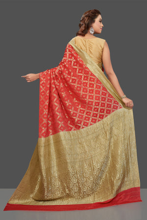 Shop stunning bright red color crepe saree online in USA with zari work. Shop for weddings and special occasions stunning tussar sarees, hand embroidered saris, crepe sarees, designer sarees in USA from Pure Elegance Indian clothing store in USA. Shop online now.-back