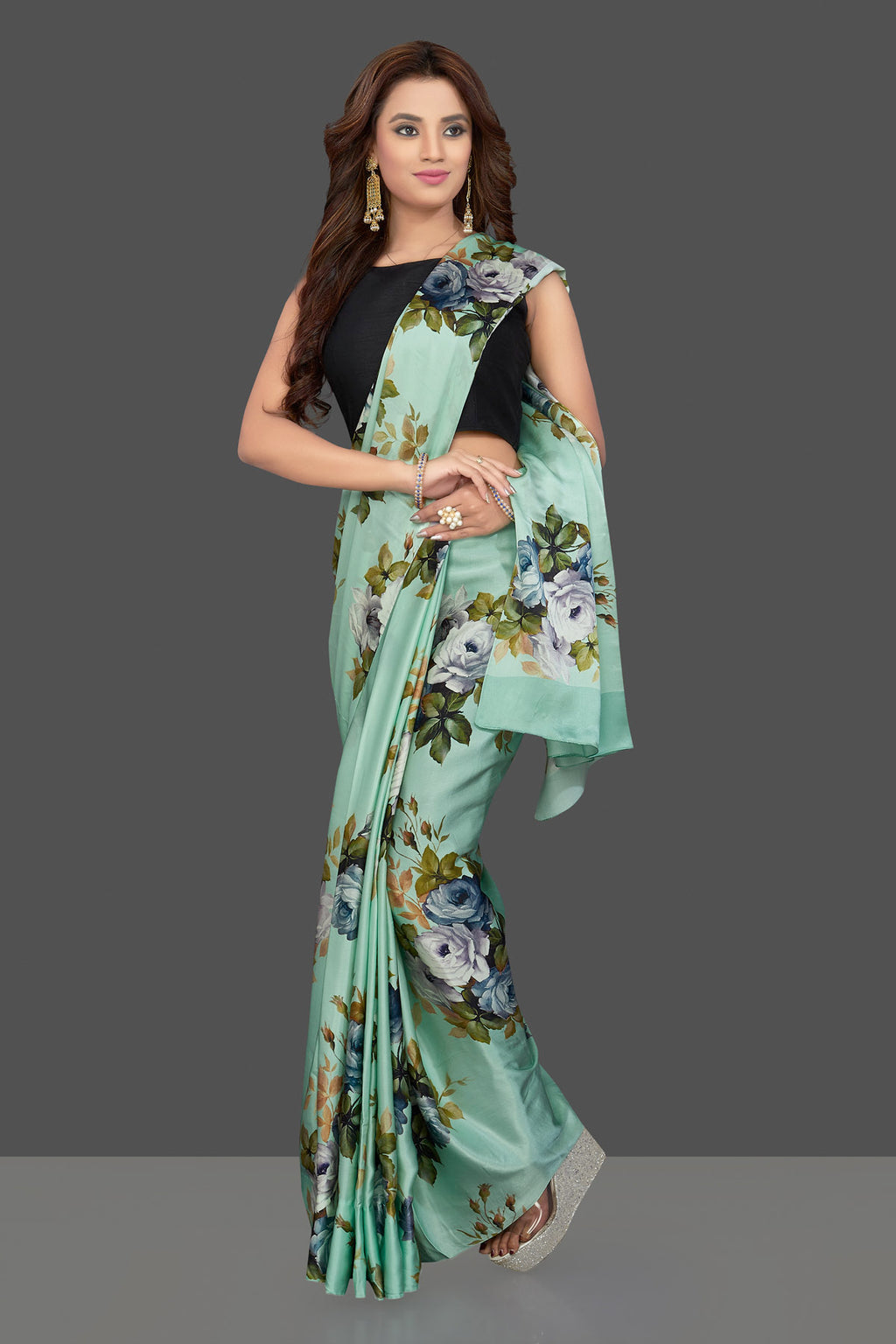 Buy stunning mint green crepe sari online in USA with rose floral print. Make you presence felt with your Indian style on special occasions in beautiful designer sarees, crepe silk sarees, georgette saris, printed sarees from Pure Elegance Indian fashion store in USA.-full view
