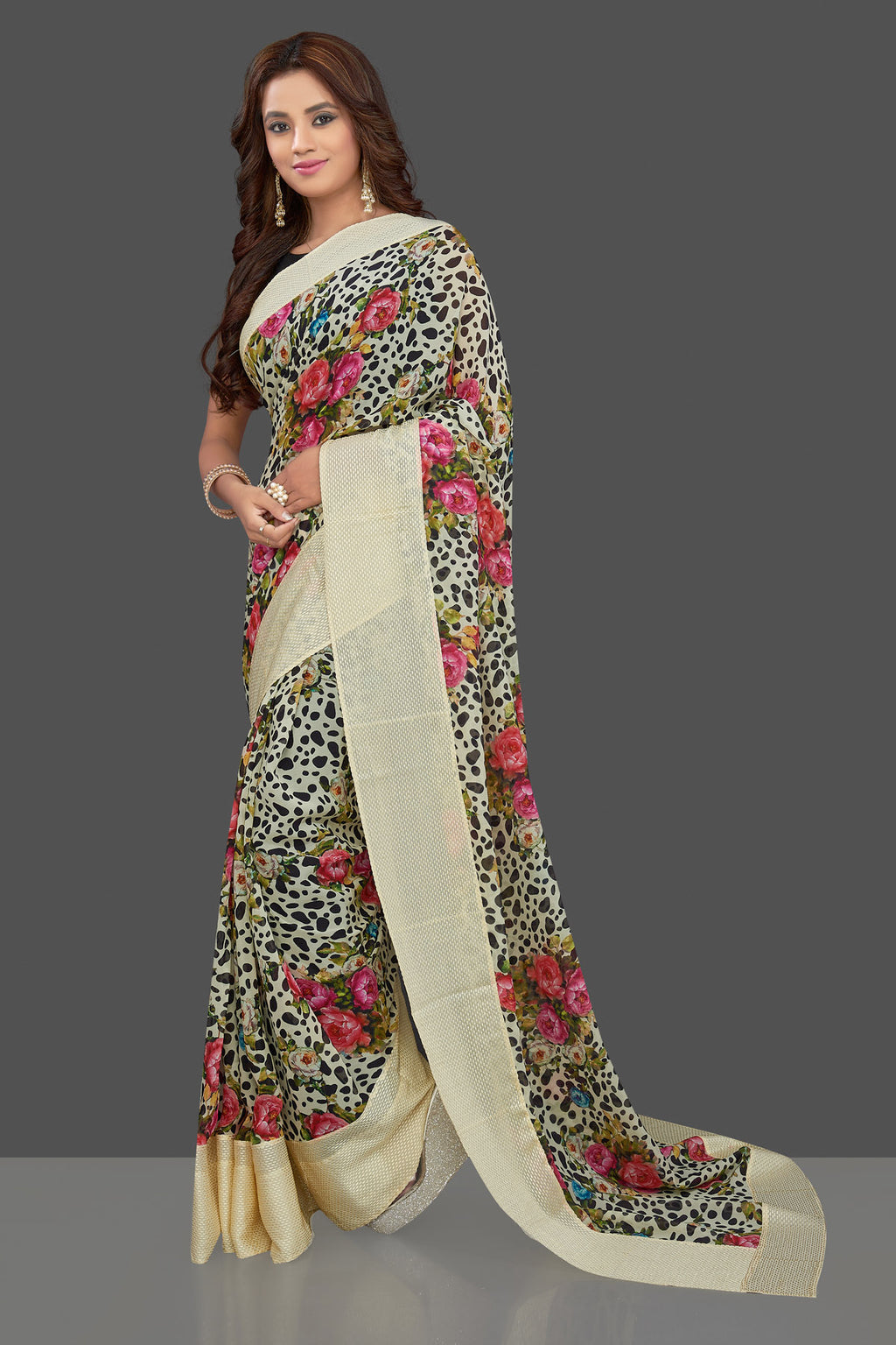 Buy stylish cream floral and leopard print georgette saree online in USA. Make you presence felt with your Indian style on special occasions in beautiful designer sarees, crepe silk sarees, georgette saris, printed sarees from Pure Elegance Indian fashion store in USA.-full view