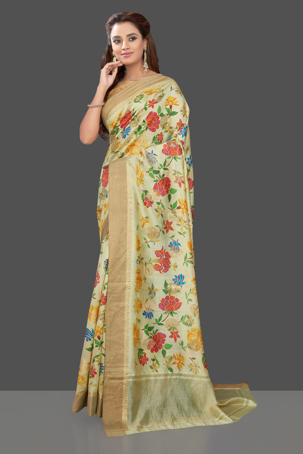 Shop gorgeous light yellow floral muga silk saree online in USA with zari border. Make you presence felt with your Indian style on special occasions in beautiful designer sarees, crepe sarees, muga silk saris, printed sarees from Pure Elegance Indian fashion store in USA.-full view