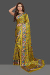 Buy stunning yellow floral print designer crepe saree online in USA. Make you presence felt with your Indian style on special occasions in beautiful handloom sarees, pure silk sarees, crepe silk sarees, printed saris from Pure Elegance Indian fashion store in USA.-full view