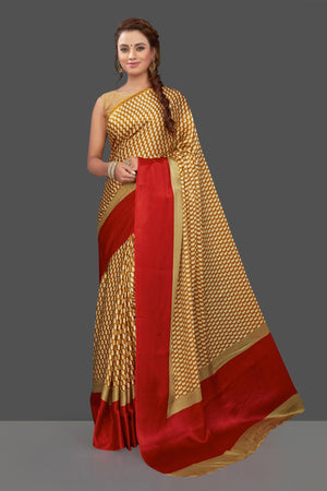Shop mustard printed crepe silk saree online in USA with solid red border. Elevate your Indian style on special occasions in beautiful designer sarees, crepe silk sarees, georgette saris, printed sarees from Pure Elegance Indian clothing store in USA.-front