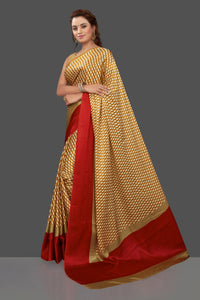 Shop mustard printed crepe silk saree online in USA with solid red border. Elevate your Indian style on special occasions in beautiful designer sarees, crepe silk sarees, georgette saris, printed sarees from Pure Elegance Indian clothing store in USA.-pallu