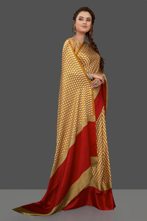 Shop mustard printed crepe silk saree online in USA with solid red border. Elevate your Indian style on special occasions in beautiful designer sarees, crepe silk sarees, georgette saris, printed sarees from Pure Elegance Indian clothing store in USA.-side