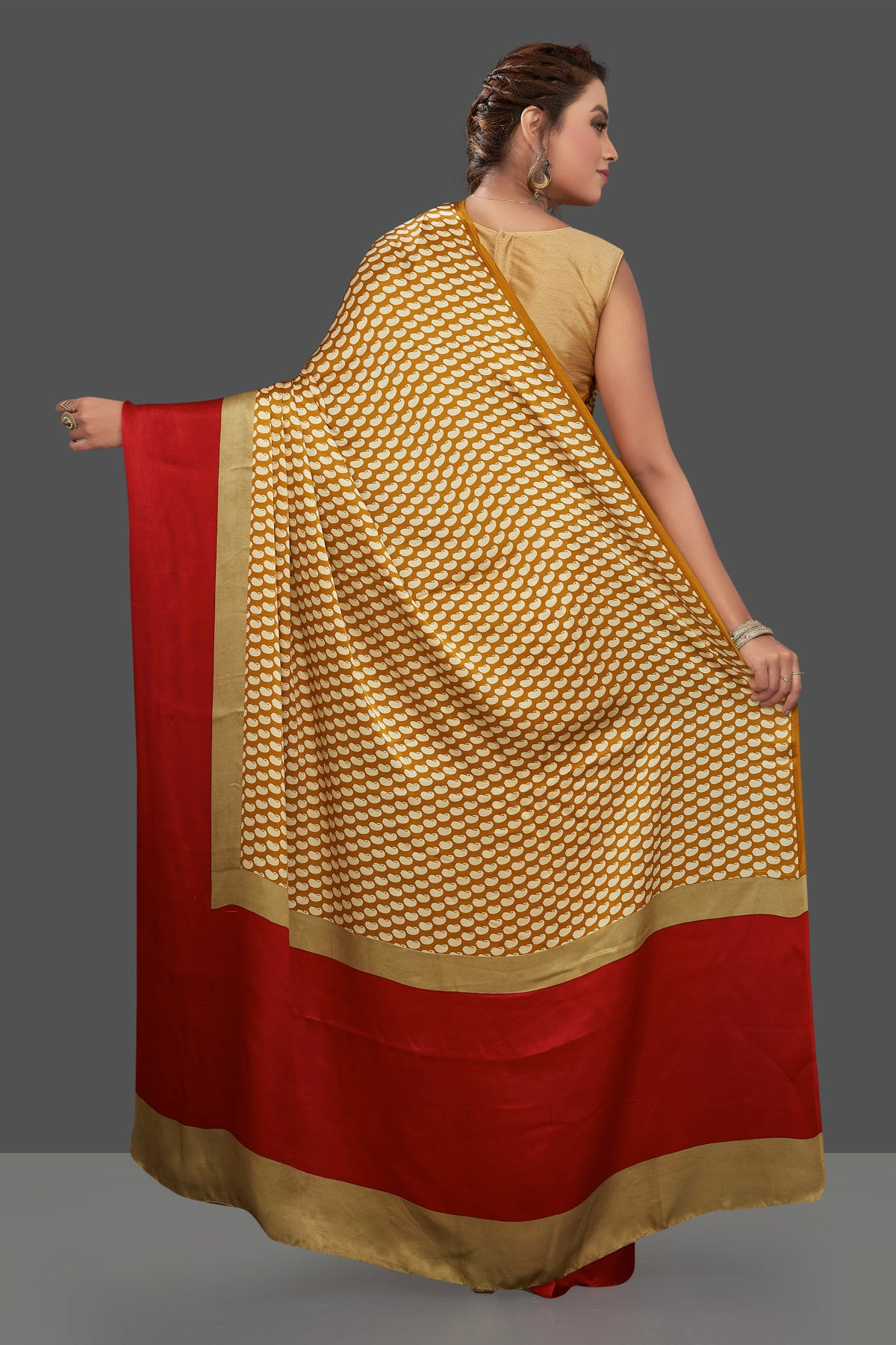 Shop mustard printed crepe silk saree online in USA with solid red border. Elevate your Indian style on special occasions in beautiful designer sarees, crepe silk sarees, georgette saris, printed sarees from Pure Elegance Indian clothing store in USA.-back