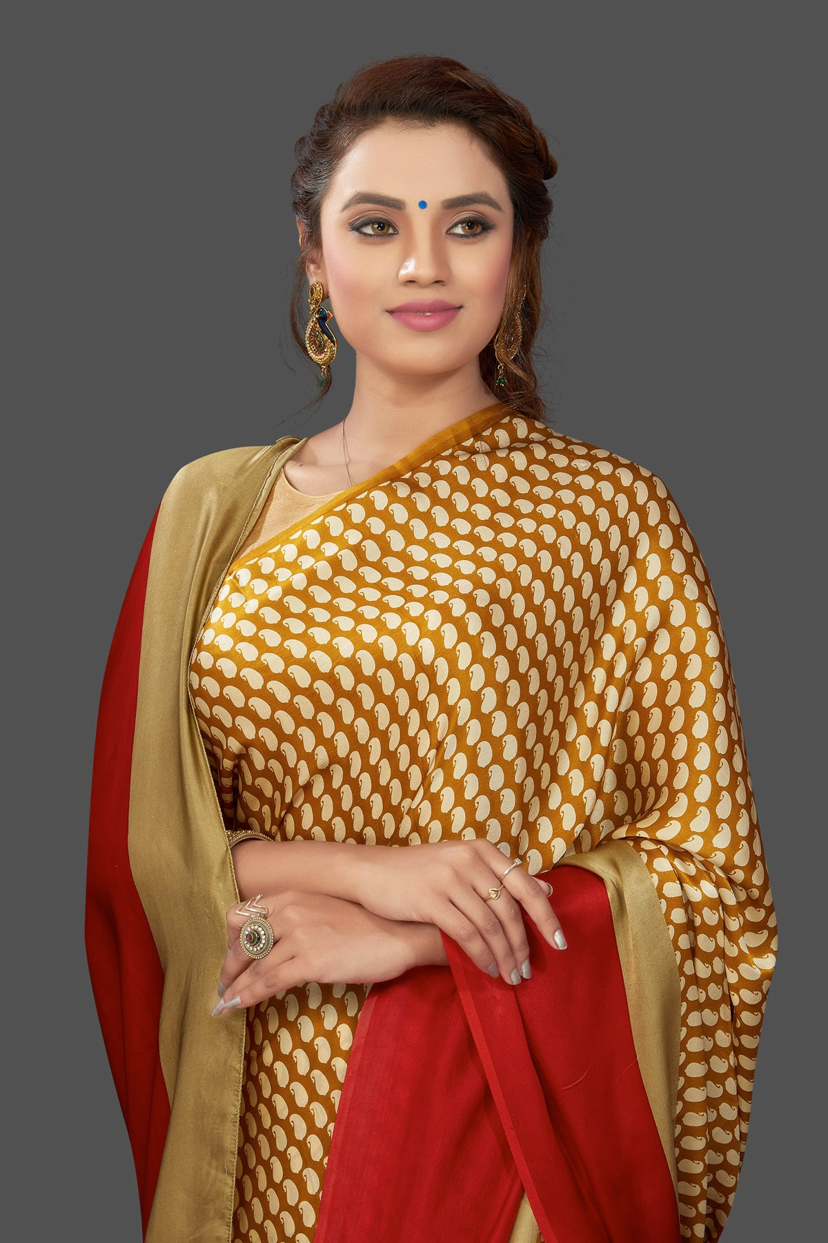 Shop mustard printed crepe silk saree online in USA with solid red border. Elevate your Indian style on special occasions in beautiful designer sarees, crepe silk sarees, georgette saris, printed sarees from Pure Elegance Indian clothing store in USA.-closeup