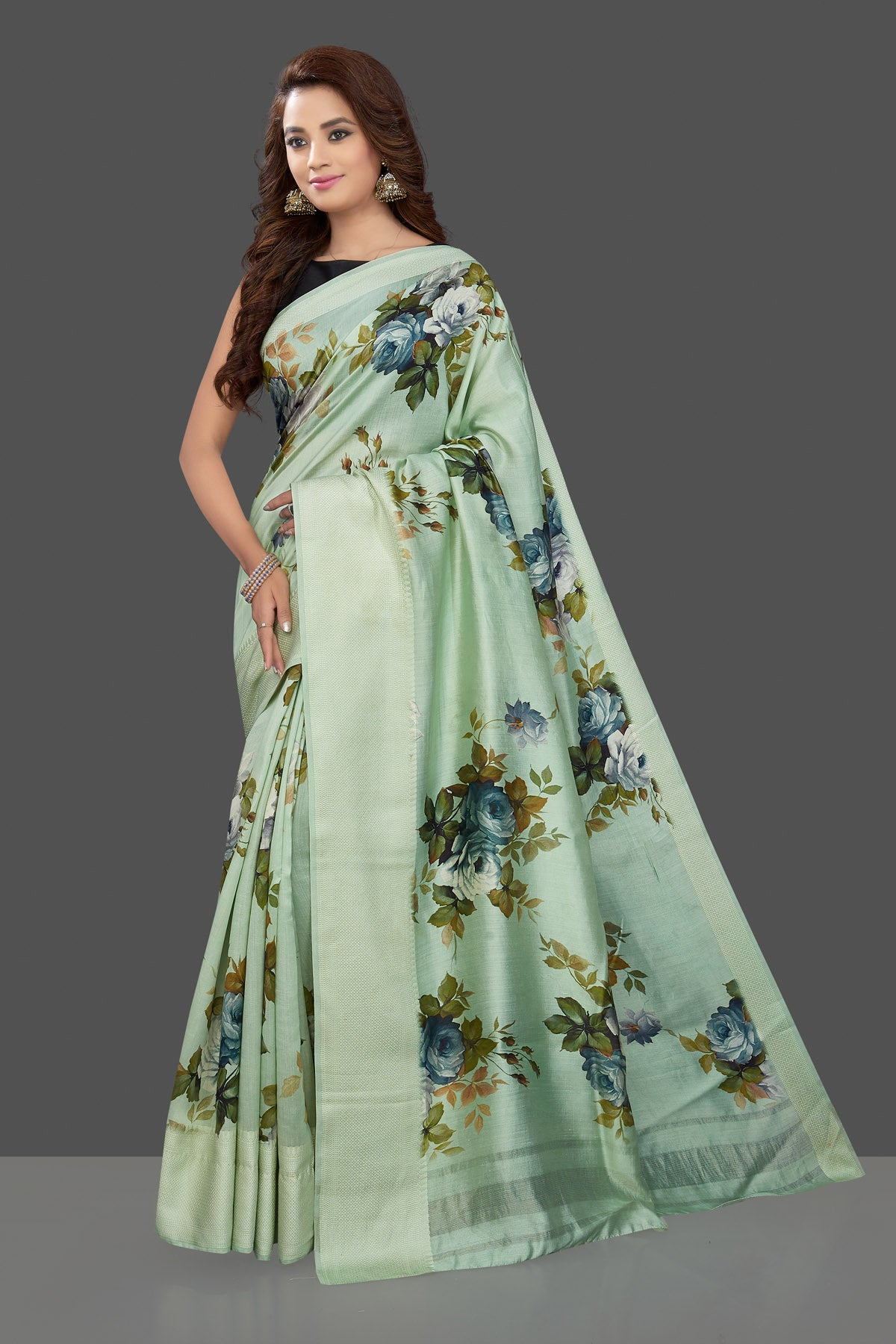 Shop beautiful mint green muga silk saree online in USA with green floral print. Make you presence felt with your Indian style on special occasions in beautiful handloom sarees, pure silk sarees, muga silk saris, printed saris from Pure Elegance Indian fashion store in USA.-side