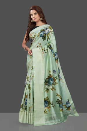 Shop beautiful mint green muga silk saree online in USA with green floral print. Make you presence felt with your Indian style on special occasions in beautiful handloom sarees, pure silk sarees, muga silk saris, printed saris from Pure Elegance Indian fashion store in USA.-full view