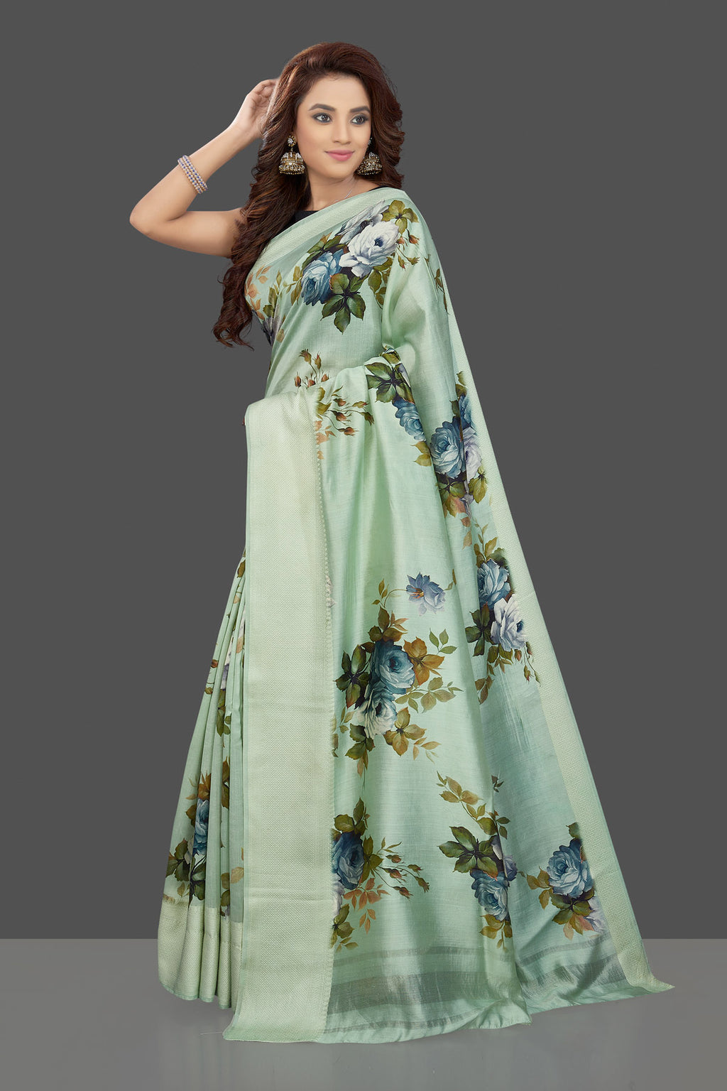 Shop beautiful mint green muga silk saree online in USA with green floral print. Make you presence felt with your Indian style on special occasions in beautiful handloom sarees, pure silk sarees, muga silk saris, printed saris from Pure Elegance Indian fashion store in USA.-pallu