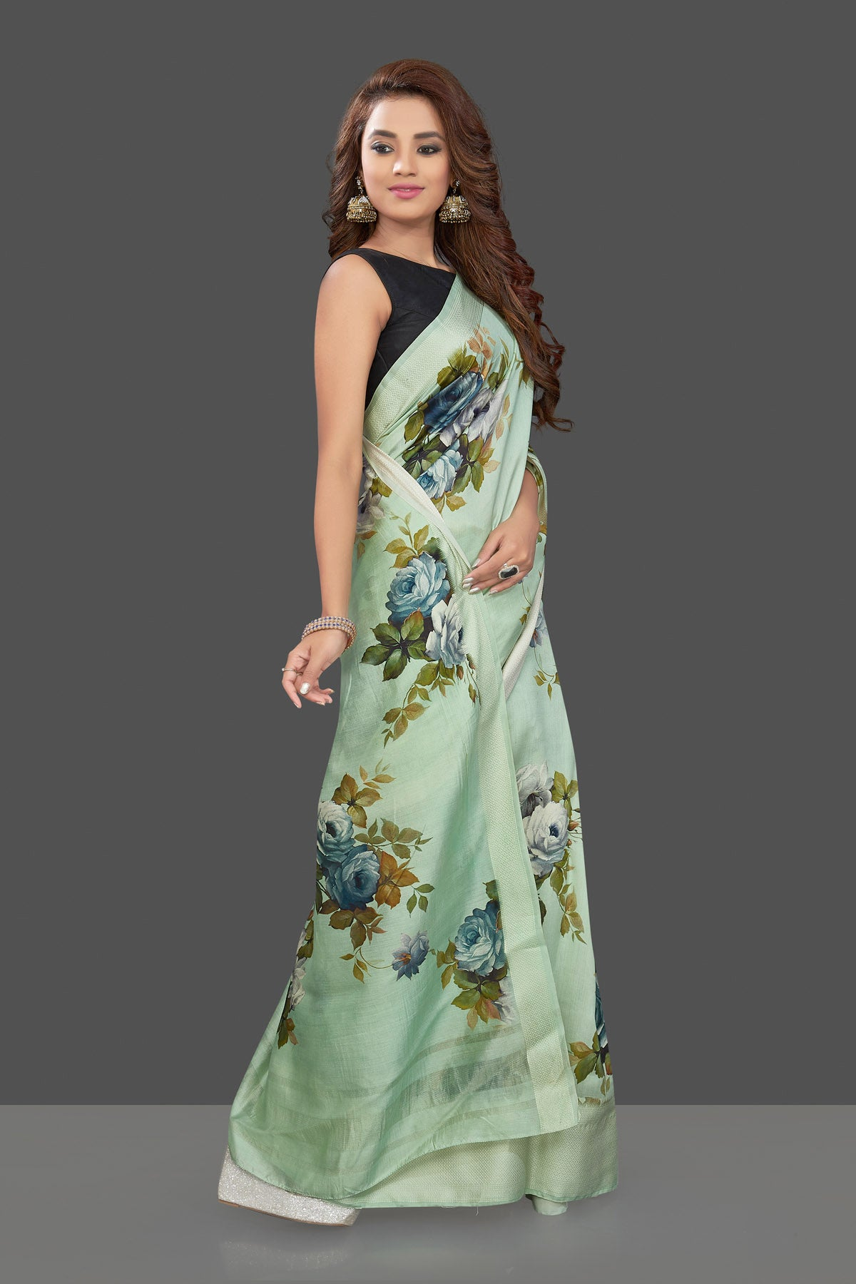 Shop beautiful mint green muga silk saree online in USA with green floral print. Make you presence felt with your Indian style on special occasions in beautiful handloom sarees, pure silk sarees, muga silk saris, printed saris from Pure Elegance Indian fashion store in USA.-right side