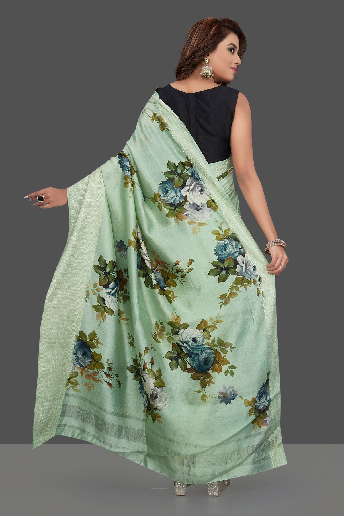 Shop beautiful mint green muga silk saree online in USA with green floral print. Make you presence felt with your Indian style on special occasions in beautiful handloom sarees, pure silk sarees, muga silk saris, printed saris from Pure Elegance Indian fashion store in USA.-back