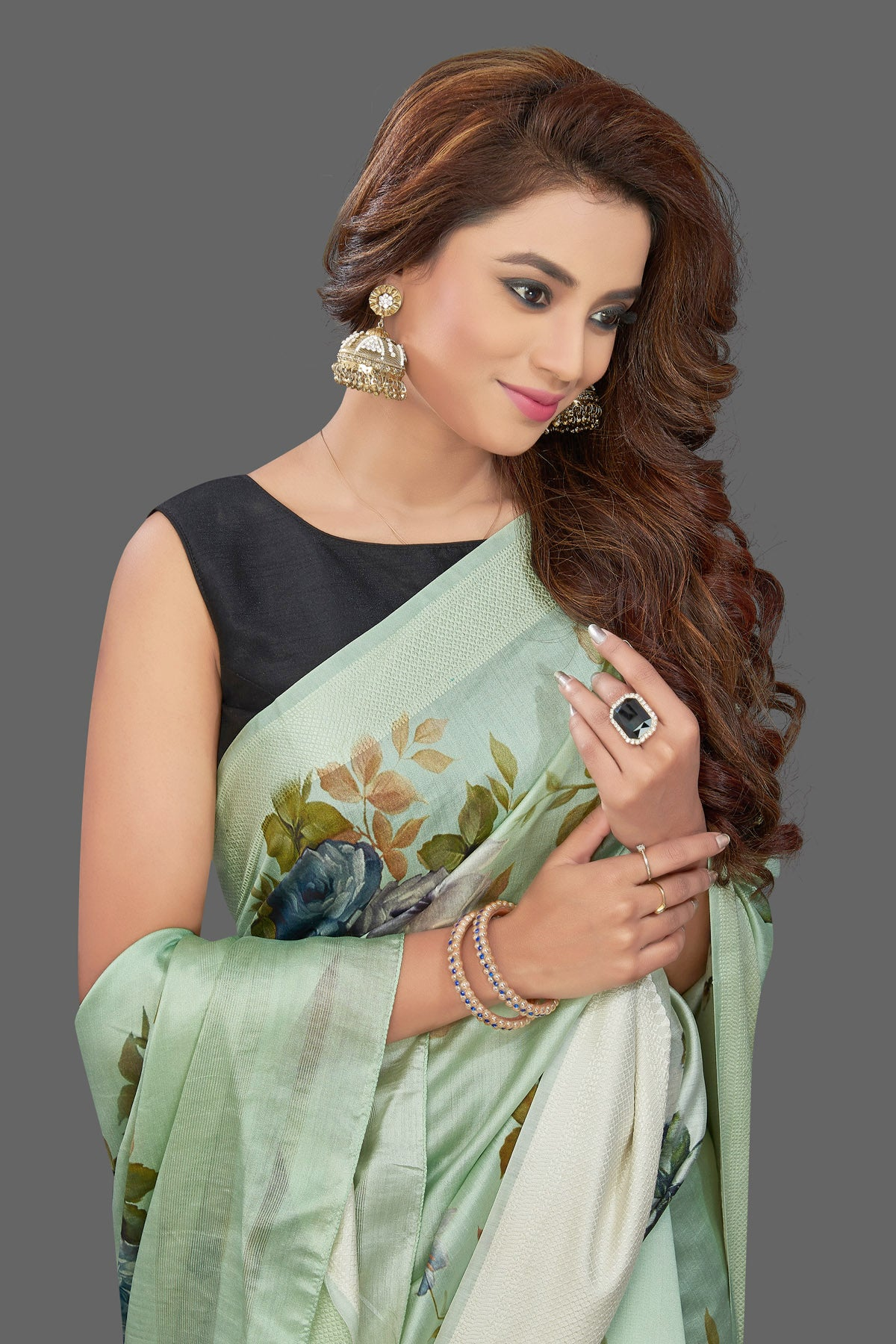 Shop beautiful mint green muga silk saree online in USA with green floral print. Make you presence felt with your Indian style on special occasions in beautiful handloom sarees, pure silk sarees, muga silk saris, printed saris from Pure Elegance Indian fashion store in USA.-closeup
