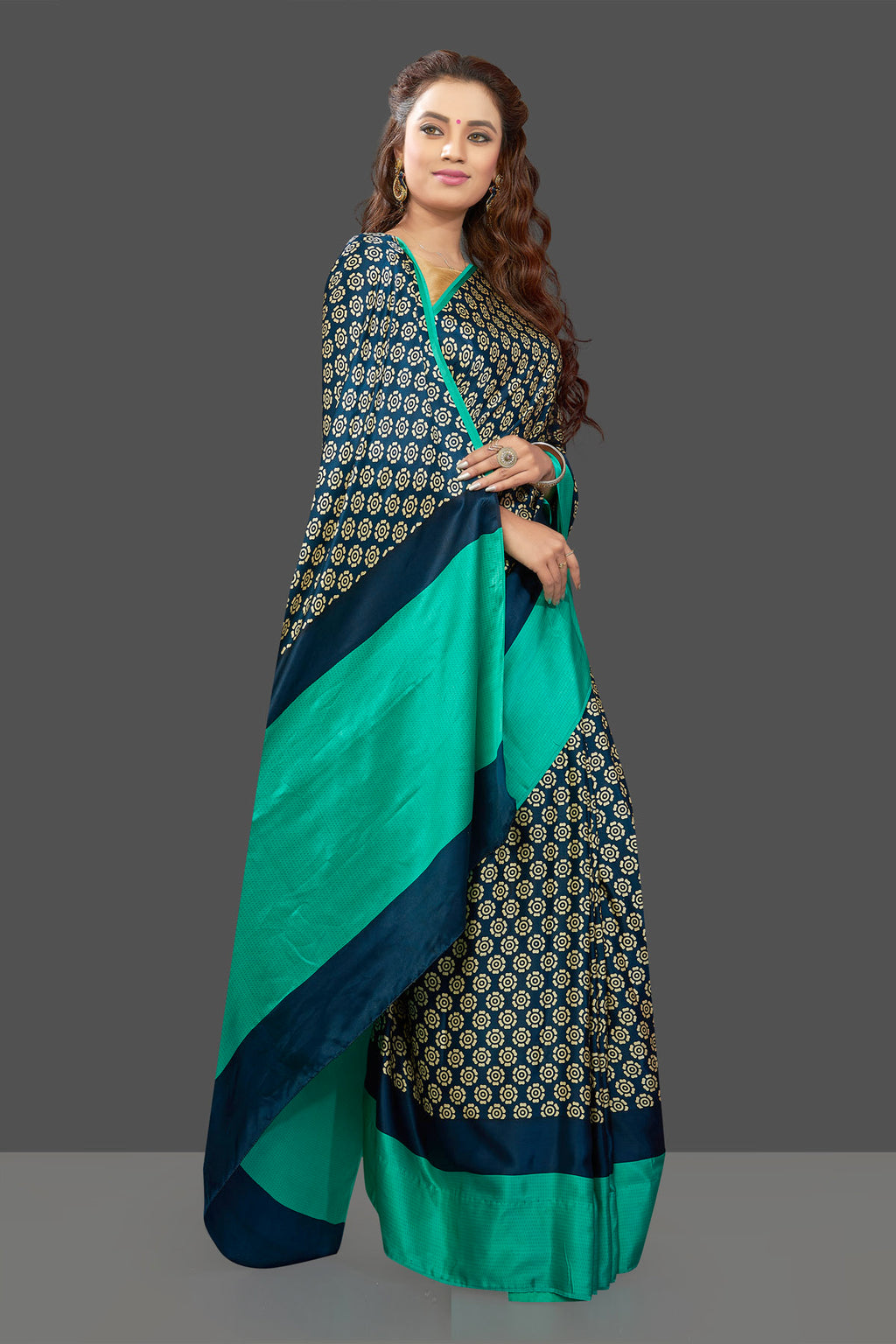 Buy elegant dark blue crepe silk sari online in USA with solid green border. Elevate your Indian style on special occasions in beautiful designer sarees, crepe silk sarees, georgette saris, printed sarees from Pure Elegance Indian clothing store in USA.-full view