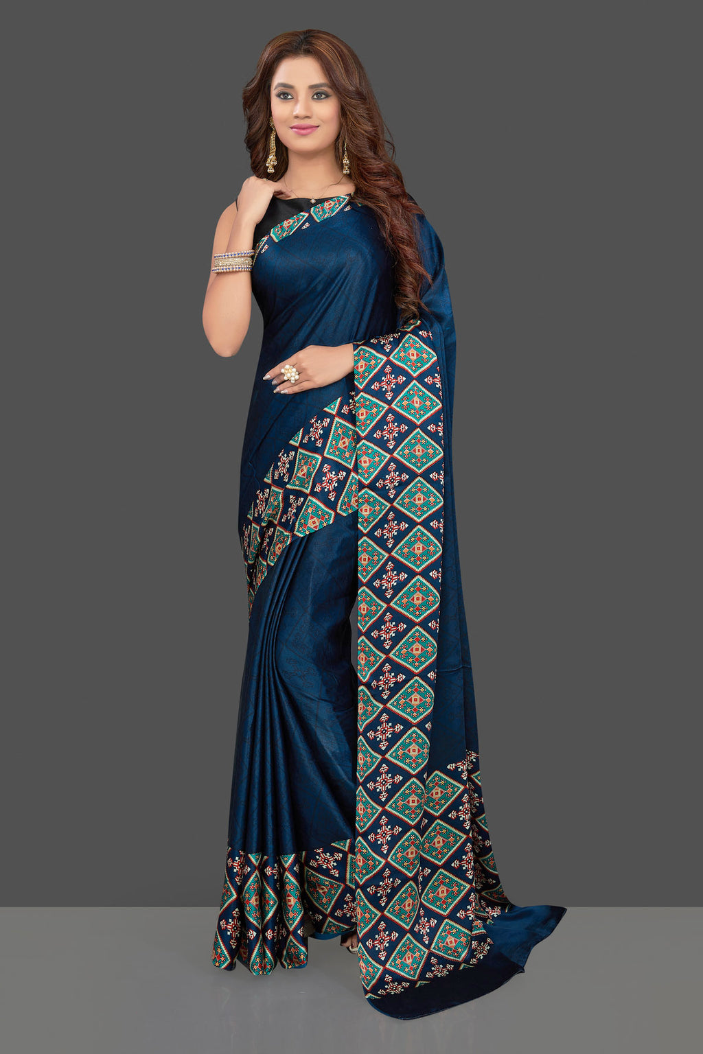 Buy dark blue crepe saree online in USA with colorful print border. Make you presence felt with your Indian style on special occasions in beautiful handloom sarees, pure silk sarees, crepe saris, printed saris from Pure Elegance Indian fashion store in USA.-full view