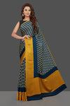 Buy gorgeous blue printed crepe saree online in USA with plain blue and yellow border. Make you presence felt with your Indian style on special occasions in beautiful handloom sarees, pure silk sarees, crepe silk sarees, printed saris from Pure Elegance Indian fashion store in USA.-full view