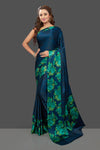 Shop blue crepe silk saree online in USA with green floral border. Elevate your Indian style on special occasions in beautiful designer sarees, crepe silk sarees, georgette saris, printed sarees from Pure Elegance Indian clothing store in USA.-full view
