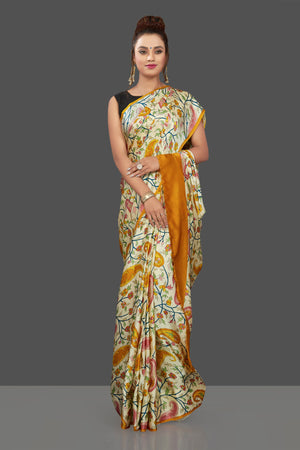 Shop elegant cream floral print crepe silk saree online in USA. Elevate your Indian style on special occasions in beautiful designer sarees, crepe silk sarees, georgette saris, printed sarees from Pure Elegance Indian clothing store in USA.-front