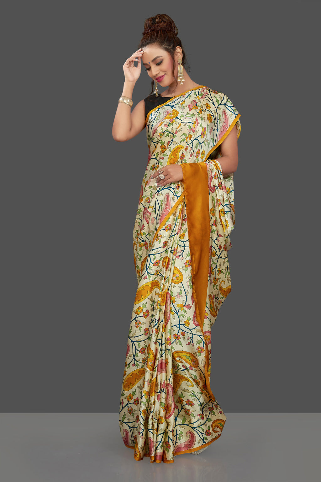 Shop elegant cream floral print crepe silk saree online in USA. Elevate your Indian style on special occasions in beautiful designer sarees, crepe silk sarees, georgette saris, printed sarees from Pure Elegance Indian clothing store in USA.-full view