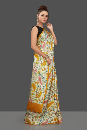 Shop elegant cream floral print crepe silk saree online in USA. Elevate your Indian style on special occasions in beautiful designer sarees, crepe silk sarees, georgette saris, printed sarees from Pure Elegance Indian clothing store in USA.-side