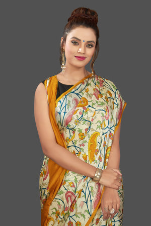 Shop elegant cream floral print crepe silk saree online in USA. Elevate your Indian style on special occasions in beautiful designer sarees, crepe silk sarees, georgette saris, printed sarees from Pure Elegance Indian clothing store in USA.-closeup