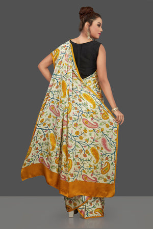 Shop elegant cream floral print crepe silk saree online in USA. Elevate your Indian style on special occasions in beautiful designer sarees, crepe silk sarees, georgette saris, printed sarees from Pure Elegance Indian clothing store in USA.-back