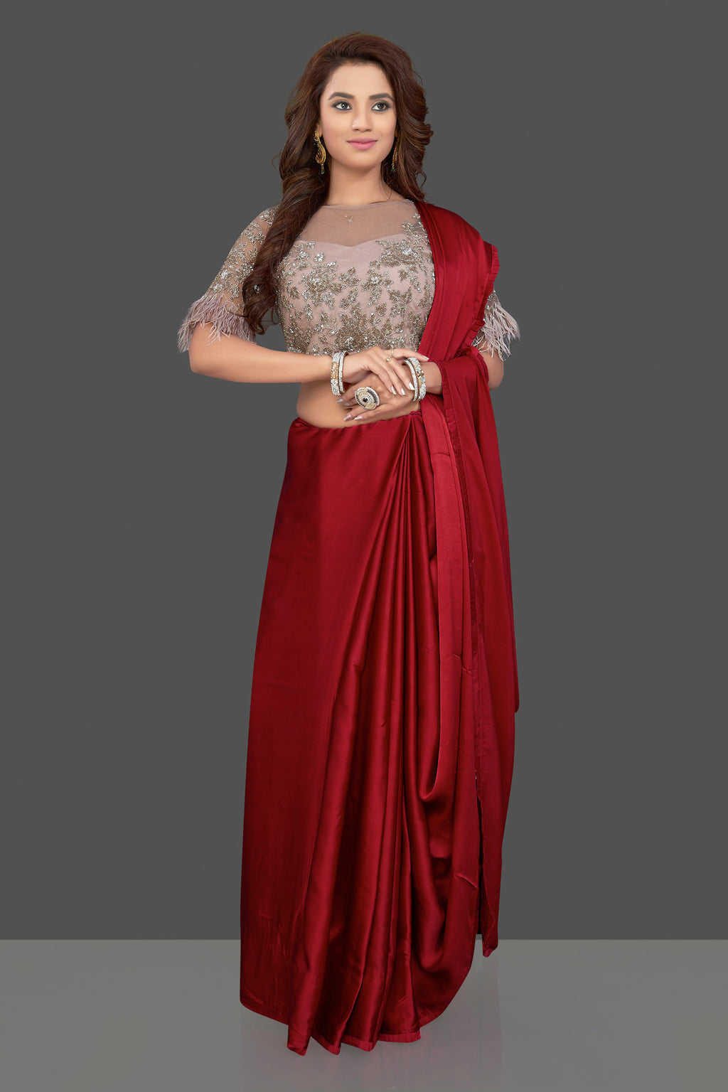 Shop stunning blood red crepe saree online in USA with dusty pink embroidered feather sleeves saree blouse. Make you presence felt with your Indian style on special occasions in beautiful handloom sarees, tussar silk sarees, embroidered sarees, Bollywood saris from Pure Elegance Indian fashion store in USA.-full view