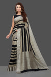Shop elegant beige and black striped matka silk saree online in USA. Make you presence felt with your Indian style on special occasions in beautiful handloom sarees, pure silk sarees, crepe silk sarees, printed saris from Pure Elegance Indian fashion store in USA.-full view