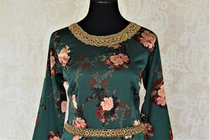 Buy dark green floral hand embroidered silk sharara suit online in USA. Elevate your ethnic style on weddings and festive occasions with stunning designer Anarkali suits, sharara suits, palazzo suits, salwar suits from Pure Elegance Indian fashion boutique in USA.-front