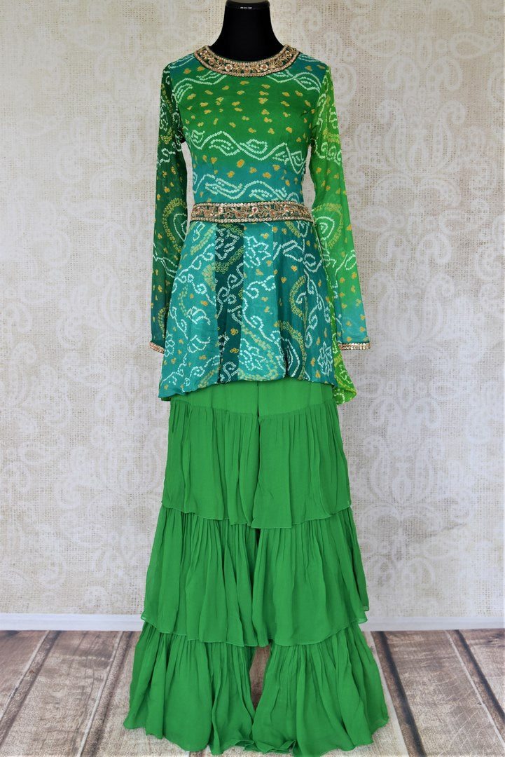 Buy attractive two-tone green silk Bandhej hand embroidered sharara suit online in USA with tiered sharara pants. Elevate your ethnic style on weddings and festive occasions with stunning designer Anarkali suits, sharara suits, palazzo suits, salwar suits from Pure Elegance Indian fashion boutique in USA.-full view