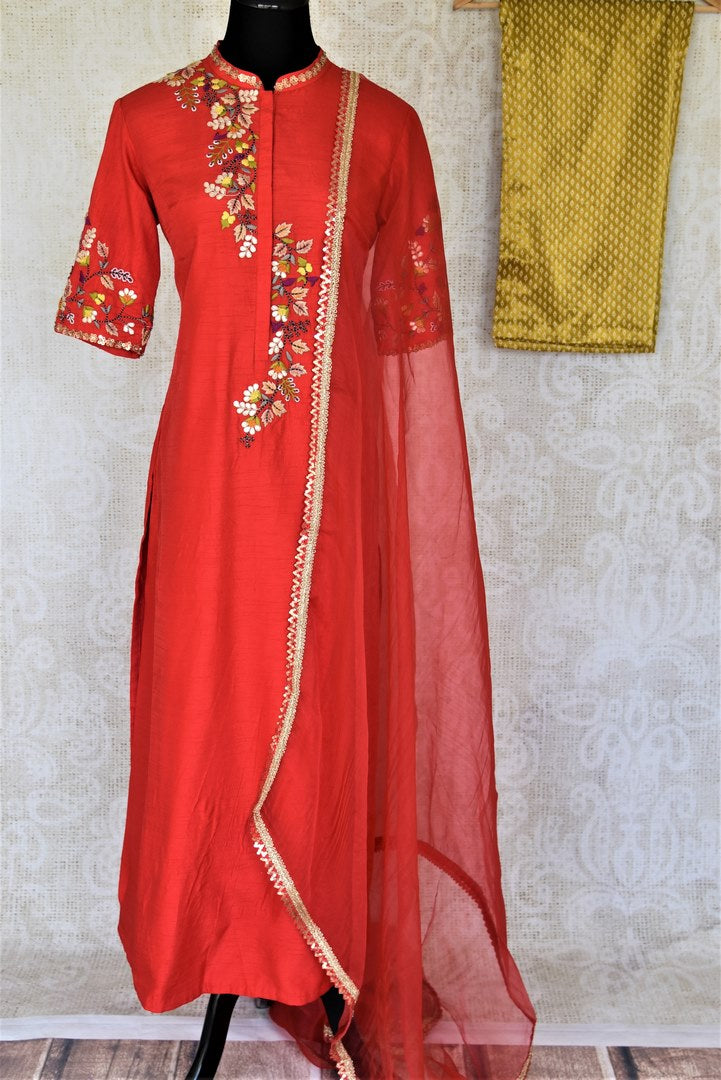 Buy elegant red embroidered silk suit online in USA with mustard pants and matching red dupatta. Elevate your ethnic style on weddings and festive occasions with stunning designer Anarkali suits, sharara suits, palazzo suits, salwar suits from Pure Elegance Indian fashion boutique in USA.-full view