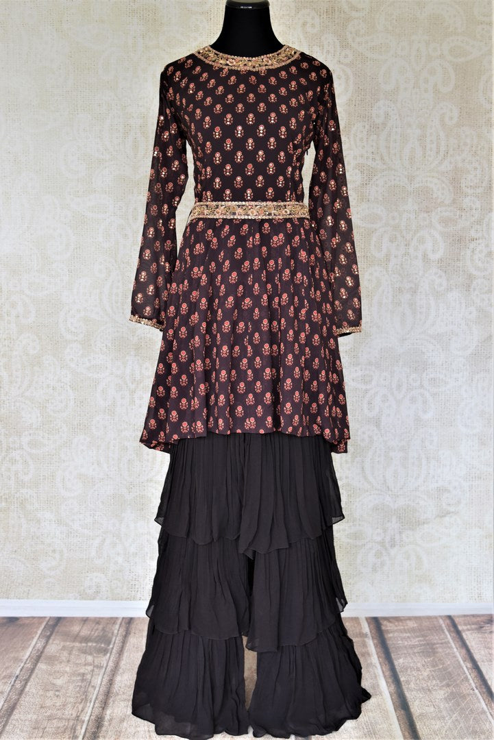 Shop gorgeous black floral print embroidered silk sharara suit online in USA with tiered sharara pants. Elevate your ethnic style on weddings and festive occasions with stunning designer Anarkali suits, sharara suits, palazzo suits, salwar suits from Pure Elegance Indian fashion boutique in USA.-full view