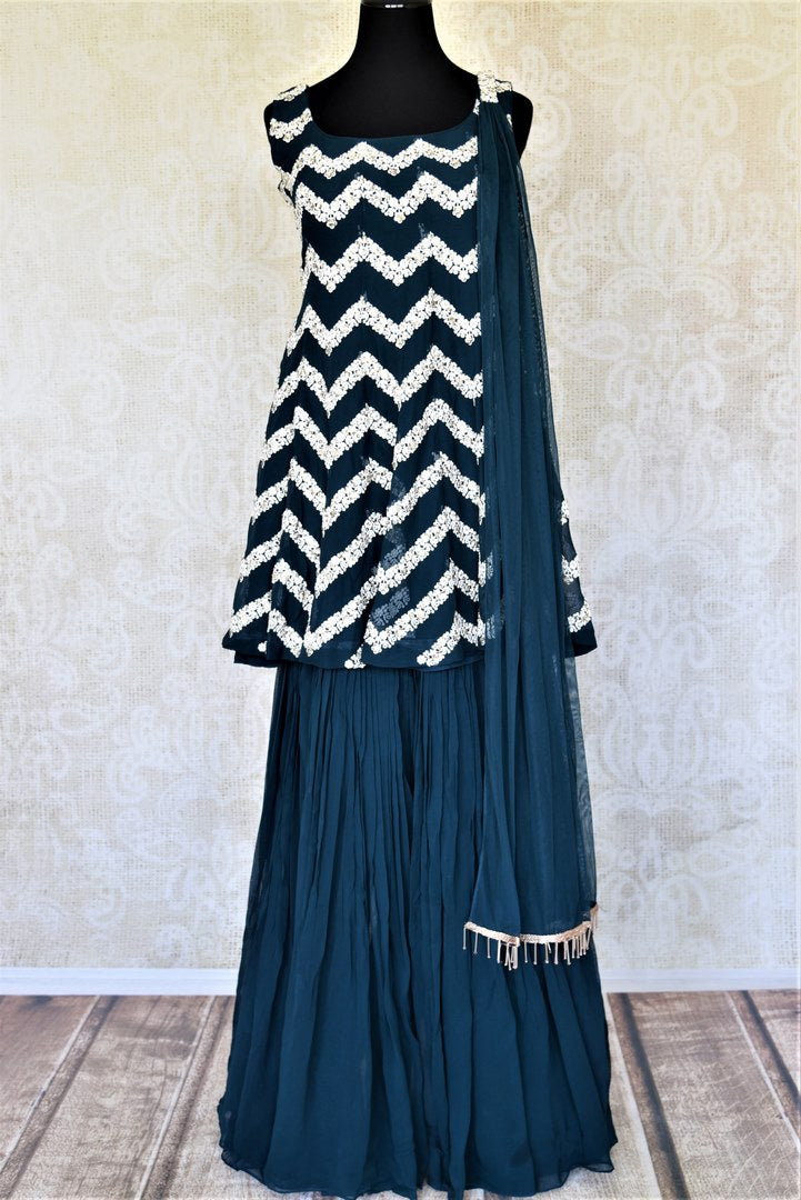 Buy stunning dark blue embroidered georgette sharara suit online in USA with dupatta. Elevate your ethnic style on weddings and festive occasions with stunning designer Anarkali suits, sharara suits, palazzo suits, salwar suits from Pure Elegance Indian fashion boutique in USA.-full view