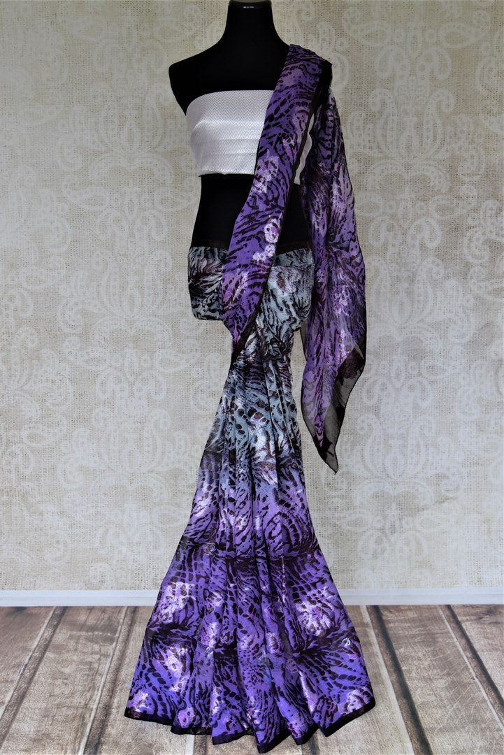 Buy stunning purple animal print georgette saree online in USA with. Elevate your ethnic style on weddings and festive occasions with stunning designer sarees, pure silk sarees, georgette sarees, printed sarees from Pure Elegance Indian fashion boutique in USA.-full view