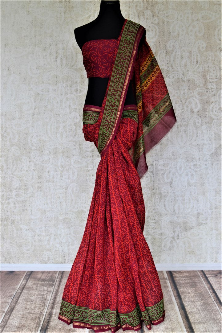Buy elegant red Kalamkari print cotton saree online in USA. Elevate your ethnic style on weddings and festive occasions with stunning designer sarees, cotton sarees, fancy sarees, printed sarees from Pure Elegance Indian fashion boutique in USA.-full view