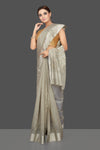 Shop attractive light grey Chanderi silk saree online in USA with silver zari border. Flaunt Indian fashion on special occasions in gorgeous chanderi sarees, pure silk sarees, Banarasi sarees, zari work sarees from Pure Elegance Indian fashion boutique in USA.-full view