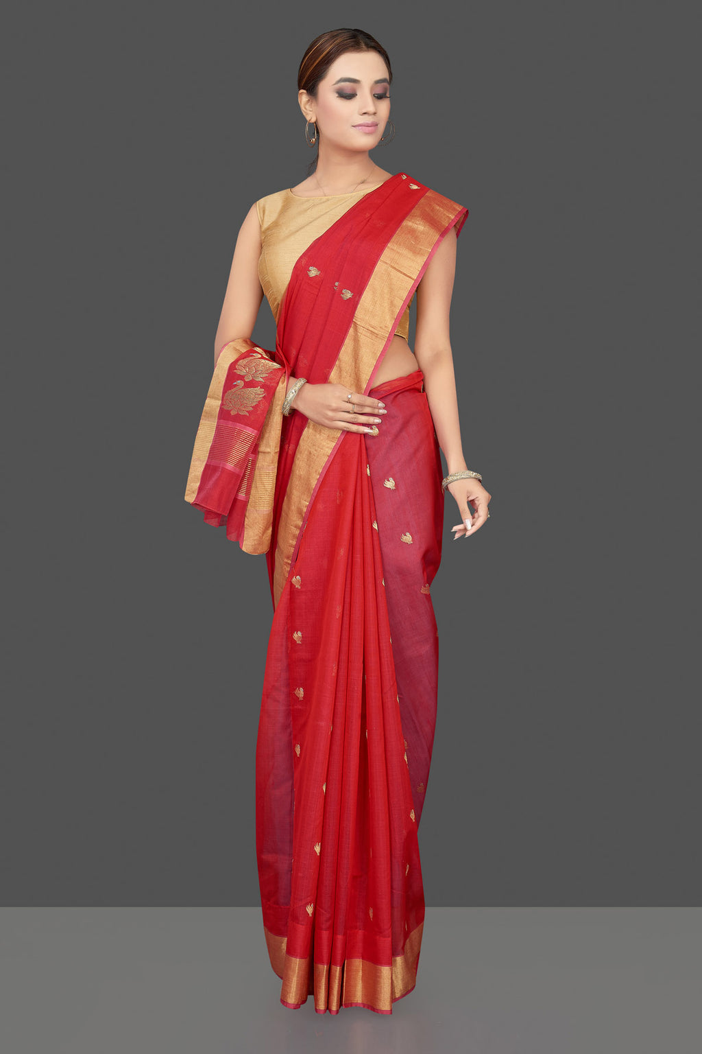 Shop stunning red Chanderi silk saree online in USA with golden zari minakari swan buta and zari border. Flaunt Indian fashion on special occasions in gorgeous chanderi sarees, pure silk sarees, Banarasi sarees, zari work sarees from Pure Elegance Indian fashion boutique in USA.-full view