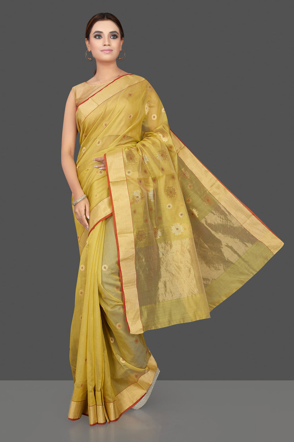 Shop charming yellow Chanderi silk sari online in USA with golden zari minakari flower buta and zari border. Flaunt Indian fashion on special occasions in gorgeous chanderi sarees, pure silk sarees, Banarasi sarees, zari work sarees from Pure Elegance Indian fashion boutique in USA.-full view