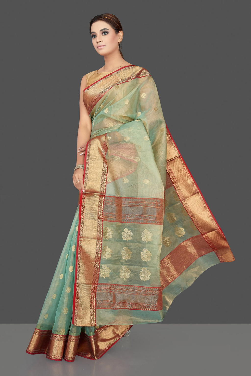 Shop beautiful green tissue silk chanderi sari online in USA with golden zari red border. Flaunt Indian fashion on special occasions in gorgeous chanderi sarees, pure silk sarees, Banarasi sarees, zari work sarees from Pure Elegance Indian fashion boutique in USA.-full view