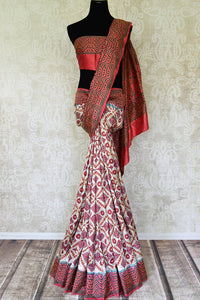 Buy elegant off-white printed silk sari online in USA with Kantha work. Go for a rich traditional style on weddings and special occasions with stunning silk sarees, handwoven saris, embroidered sarees from Pure Elegance Indian saree store in USA.-full view