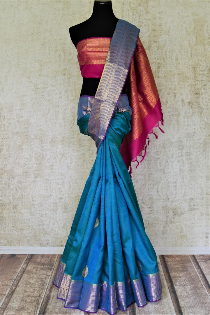 Shop stunning blue Kanjivaram saree online in USA with silver zari border and pink zari pallu. Shop for weddings and festive occasions stunning handwoven silk sarees, pure silk sarees, Kanjeevaram sarees from Pure Elegance Indian saree store in USA.-full view