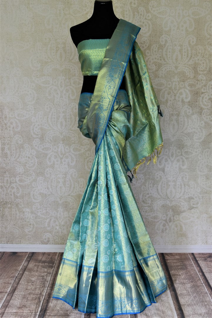 Shop beautiful blue Kanjeevaram saree online in USA with overall golden zari work. Shop for weddings and festive occasions stunning handwoven silk sarees, pure silk sarees, Kanjeevaram sarees from Pure Elegance Indian saree store in USA.-full view