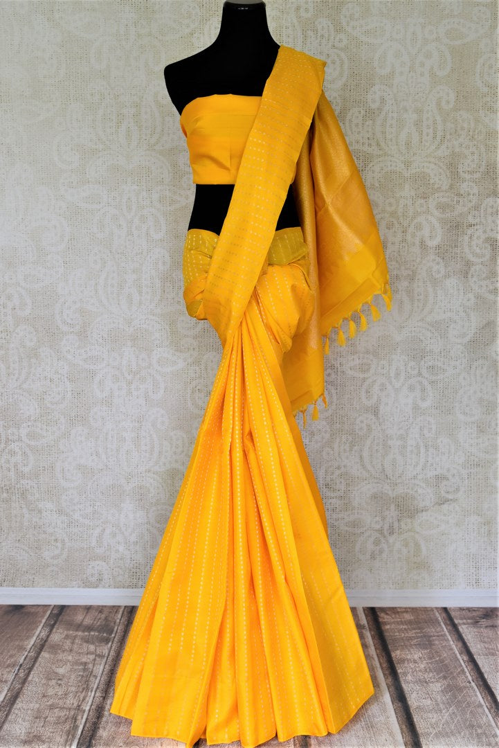 Shop stunning yellow borderless Kanjvaram saree online in USA. Shop for weddings and special occasions beautiful Kanchipuram silk sarees, soft silk sarees, pure zari work sarees, handwoven sarees from Pure Elegance Indian saree store in USA.-full view