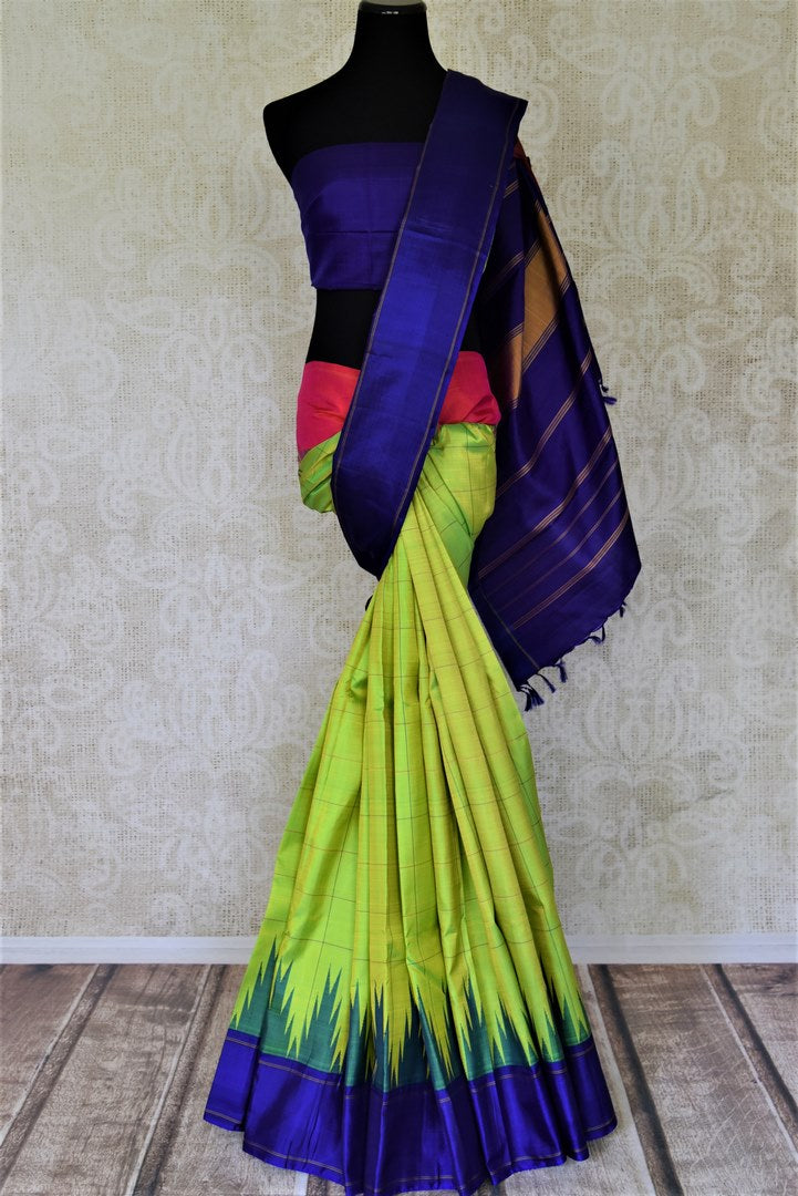 Shop stunning golden green Kanjivaram sari online in USA with blue temple border. Shop for weddings and festive occasions stunning handwoven silk sarees, pure silk sarees, Kanjeevaram sarees from Pure Elegance Indian saree store in USA.-full view