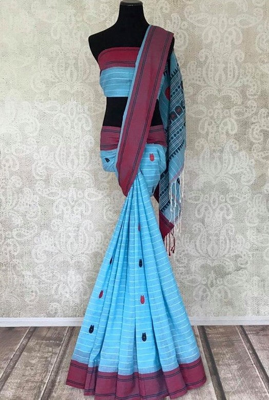 Shop gorgeous sky blue Bhagalpuri linen sari online in USA. Shop handowoven silk sarees, designer saris, linen sarees, embroidered sarees in USA from Pure Elegance Indian saree store in USA.-full view