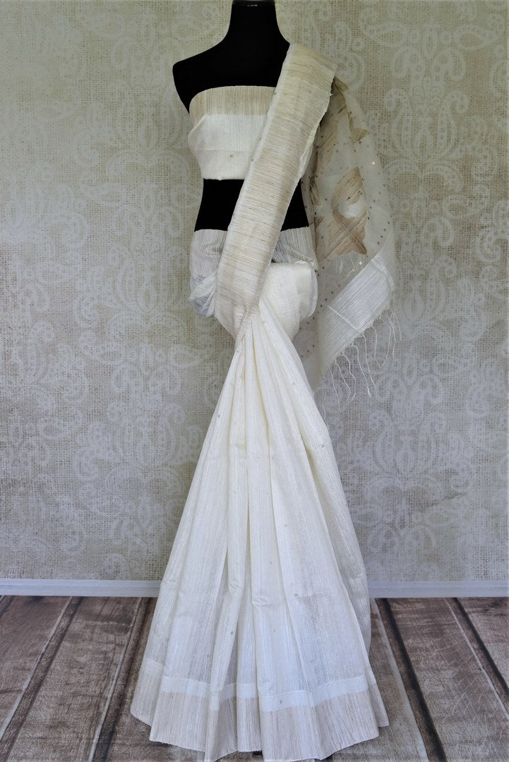 Shop stunning off-white matka silk saree online in USA with sequin work. Shop handowoven silk sarees, designer saris, linen sarees, embroidered sarees in USA from Pure Elegance Indian saree store in USA.-full view