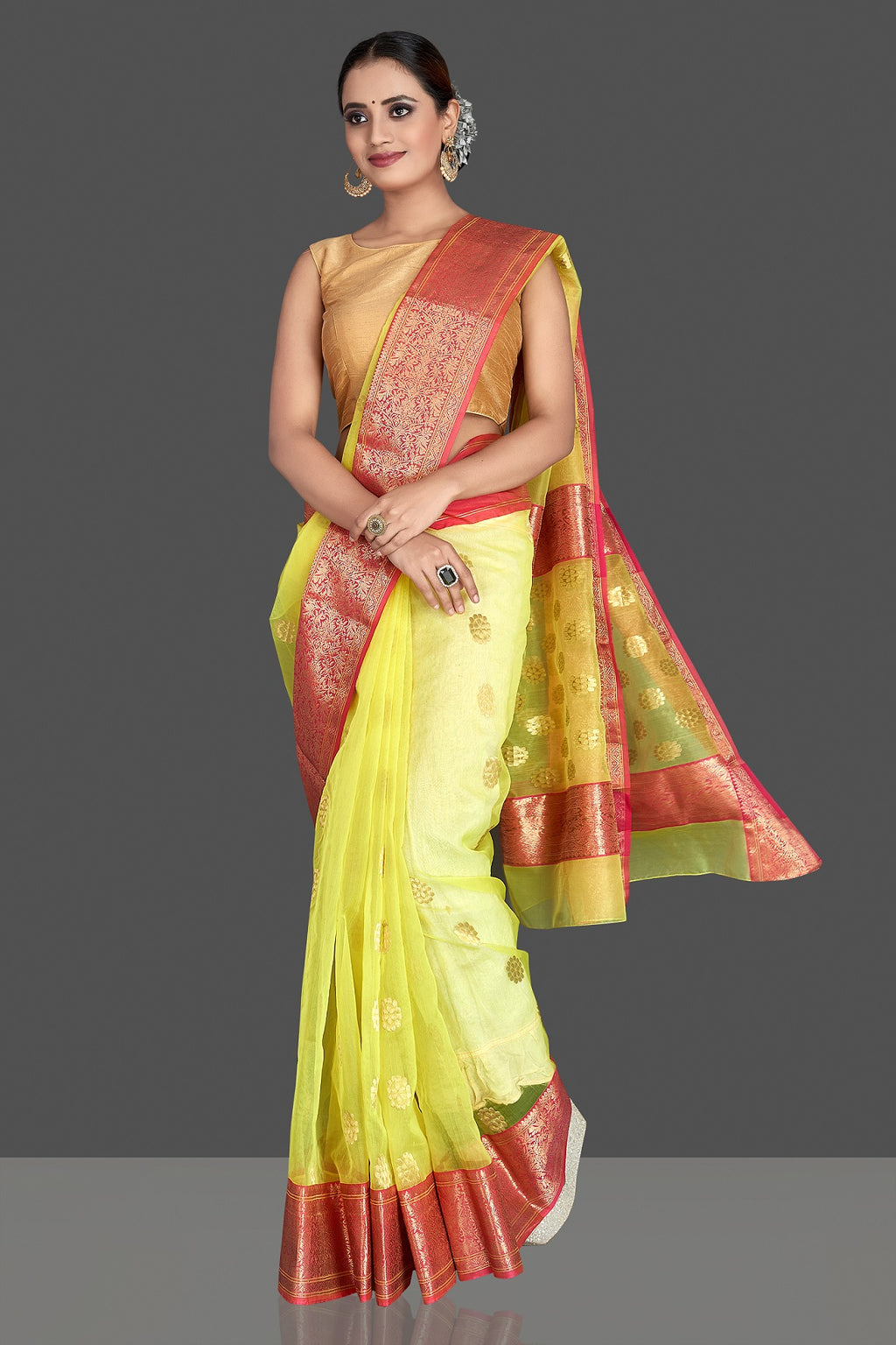 Shop stunning yellow chanderi silk saree online in USA with pink zari border. Buy gorgeous Indian designer sarees, pure handwoven sarees, zari work sarees, Maheshwari sarees, chanderi saris in USA from Pure Elegance Indian fashion store.-full view