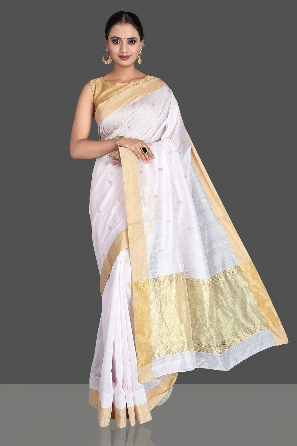 Shop white tissue chanderi saree online in USA with golden zari border and buta. Buy gorgeous Indian designer sarees, pure handwoven sarees, zari work sarees, Maheshwari sarees, chanderi saris in USA from Pure Elegance Indian fashion store.-full view